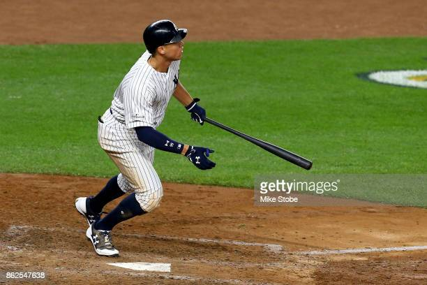 Aaron Judge of the New York Yankees hits a solo home run during the seventh inning against the Houston Astros in Game Four of the American League...