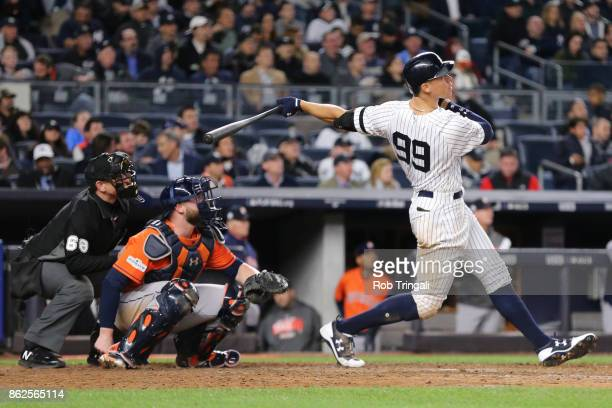 Aaron Judge of the New York Yankees hits a solo home run in the eighth inning during Game 4 of the American League Championship Series against the...
