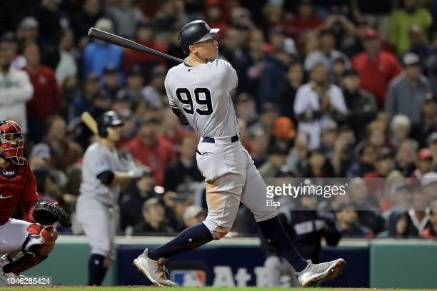 Aaron Judge of the New York Yankees hits a solo home run in the ninth inning against the Boston Red Sox in Game One of the American League Division...