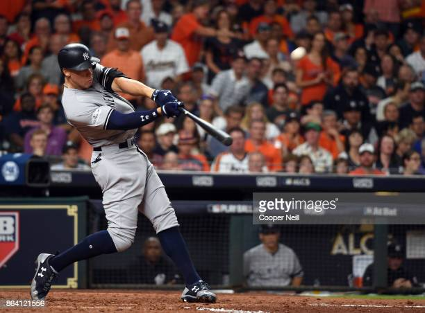 Aaron Judge of the New York Yankees hits a solo home run in the eighth inning of Game 6 of the American League Championship Series against the...