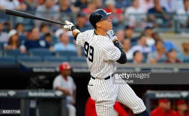 Aaron Judge of the New York Yankees hits a threerun home run against the Los Angeles Angels of Anaheim during the second inning of a game at Yankee...