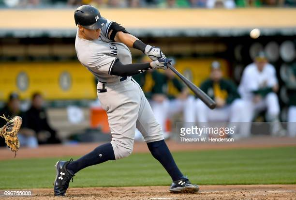 Aaron Judge of the New York Yankees hits a threerun homer against the Oakland Athletics in the top of the third inning at Oakland Alameda Coliseum on...