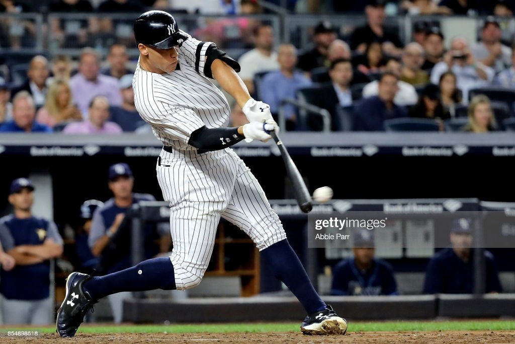Aaron Judge #99 of the New York Yankees hits a two run double to score Jacoby Ellsbury #22 and Aaron Hicks #31 of the New York Yankees against the Tampa Bay Rays at Yankee Stadium on September 27, 2017 in the Bronx borough of New York City.