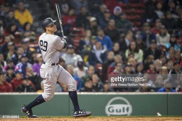 Aaron Judge of the New York Yankees hits a two run home run during the second inning of a game against the Boston Red Sox on April 26 2017 at Fenway...