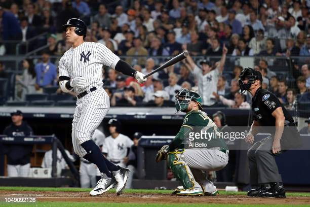 Aaron Judge of the New York Yankees hits a two run home run in the first inning against the Oakland Athletics during the American League Wild Card...