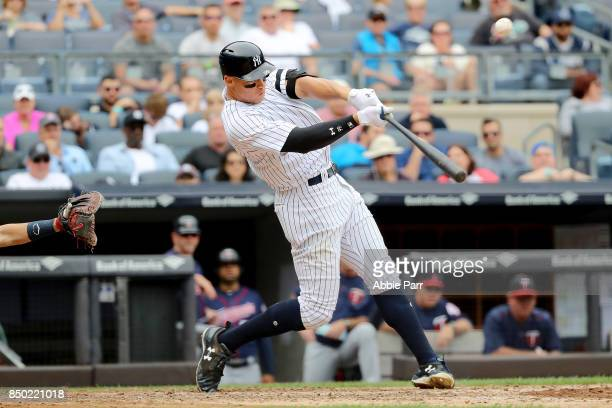 Aaron Judge of the New York Yankees hits a two run home run in the third inning against Minnesota Twins on September 20 2017 at Yankee Stadium in the...