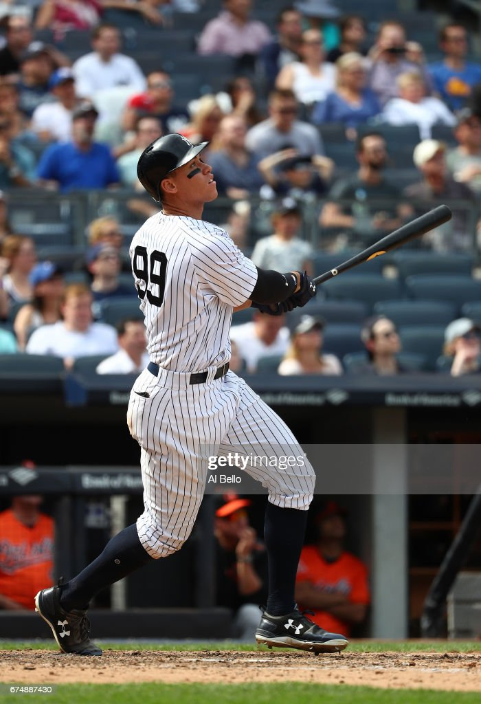 Aaron Judge #99 of the New York Yankees hits a two-run home run against Jayson Aquino #64 of the Baltimore Orioles in the seventh inning during their game at Yankee Stadium on April 29, 2017 in New York City.