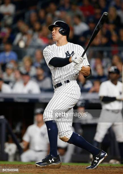 Aaron Judge of the New York Yankees hits a tworun home run against the Boston Red Sox during the sixth inning of a game at Yankee Stadium on...
