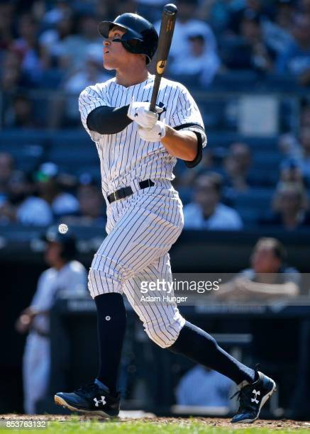 Aaron Judge of the New York Yankees hits a tworun home run against the Kansas City Royals during the third inning at Yankee Stadium on September 25...