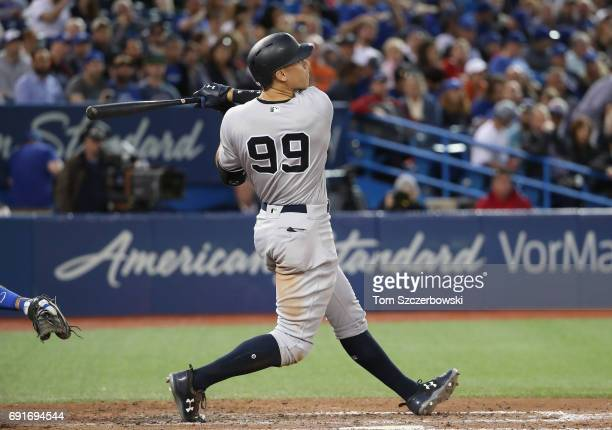 Aaron Judge of the New York Yankees hits a tworun home run in the sixth inning during MLB game action against the Toronto Blue Jays at Rogers Centre...