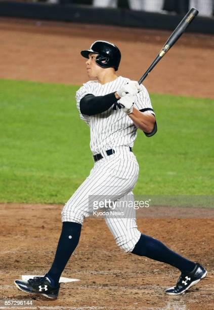 Aaron Judge of the New York Yankees hits a tworun home run in the fourth inning of the American League wildcard game against the Minnesota Twins at...