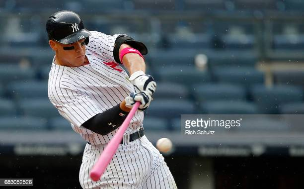 Aaron Judge of the New York Yankees hits a tworun homer during the fourth inning against the Houston Astros during game one of a doubleheader at...