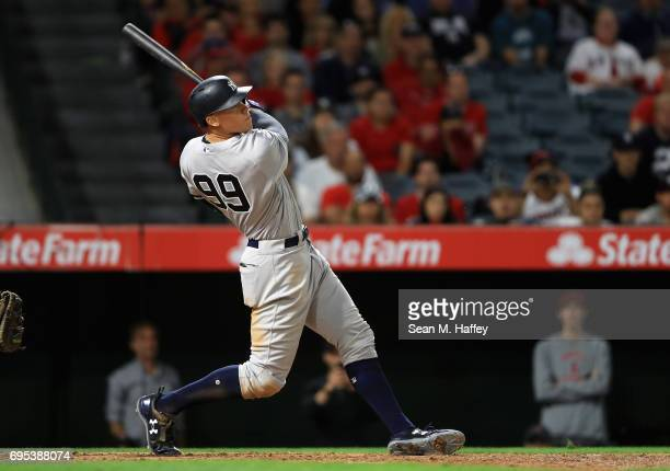 Aaron Judge of the New York Yankees hits a tworun homerun during the eighth inning of a game against the Los Angeles Angels of Anaheim at Angel...