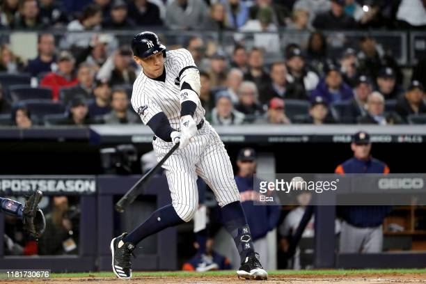 Aaron Judge of the New York Yankees hits into a fielders choice against the Houston Astros during the first inning in game four of the American...