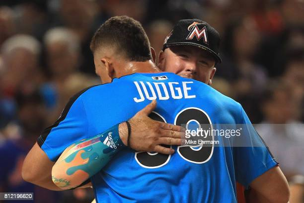 Aaron Judge of the New York Yankees hugs Justin Bour of the Miami Marlins during the TMobile Home Run Derby at Marlins Park on July 10 2017 in Miami...