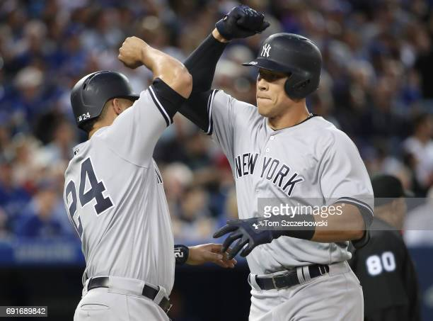 Aaron Judge of the New York Yankees is congratulated by Gary Sanchez after hitting a tworun home run in the sixth inning during MLB game action...