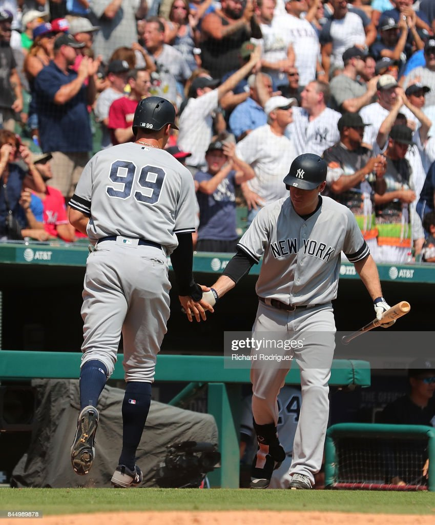 Aaron Judge #99 of the New York Yankees is greeted by Chase Headley #12 of the New York Yankees after scoring the go-ahead run in the 9th inning agaisnt the Texas Rangers at Globe Life Park in Arlington on September 9, 2017 in Arlington, Texas.