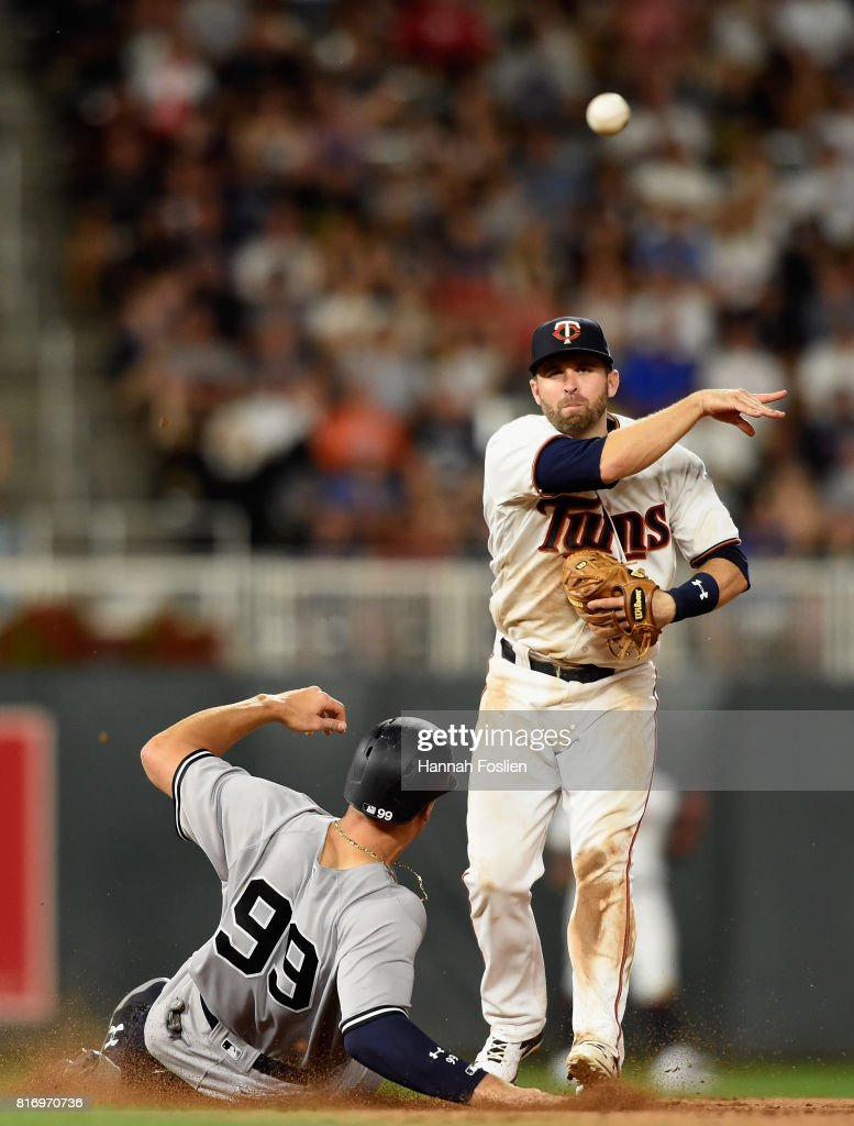 Aaron Judge #99 of the New York Yankees is out at second base as Brian Dozier #2 of the Minnesota Twins turns a double play during the eighth inning of the game on July 17, 2017 at Target Field in Minneapolis, Minnesota. The Twins defeated the Yankees 4-2.