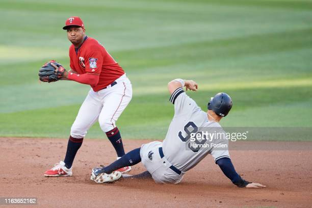 Aaron Judge of the New York Yankees is out at second base as Jonathan Schoop of the Minnesota Twins turns a triple play during the first inning of...