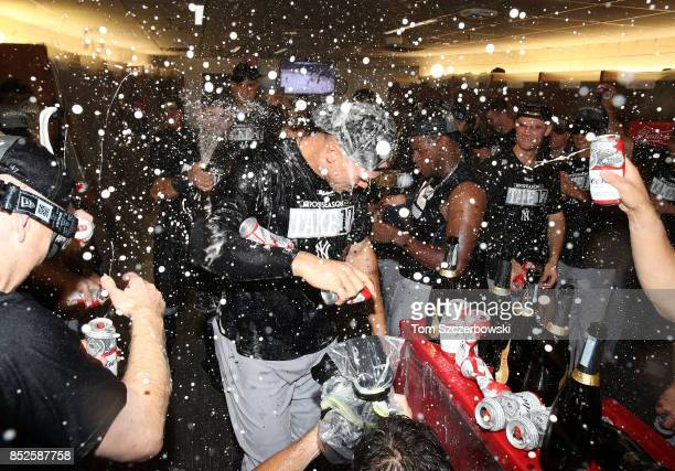 Aaron Judge of the New York Yankees is sprayed by teammates in the clubhouse as they celebrate their playoffclinching victory during MLB game action...