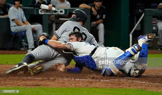 Aaron Judge of the New York Yankees is tagged out by Cam Gallagher of the Kansas City Royals at the plate in the seventh inning at Kauffman Stadium...