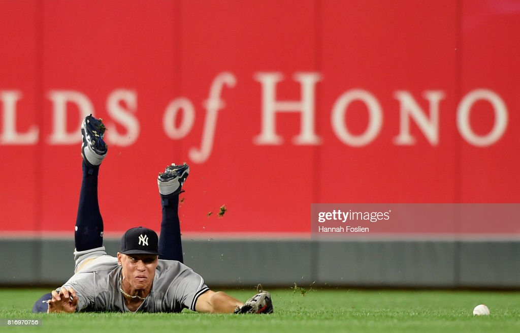 Aaron Judge #99 of the New York Yankees is unable to catch a single hit by Joe Mauer #7 of the Minnesota Twins during the eighth inning of the game on July 17, 2017 at Target Field in Minneapolis, Minnesota. The Twins defeated the Yankees 4-2.