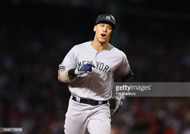 Aaron Judge of the New York Yankees jogs toward home plate on his solo home run during the first inning of Game Two of the American League Division...