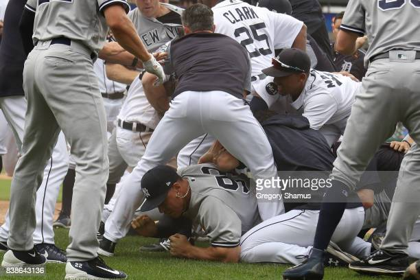 Aaron Judge of the New York Yankees lays on the ground during a bench clearing fight in the sixth inning against the Detroit Tigers at Comerica Park...