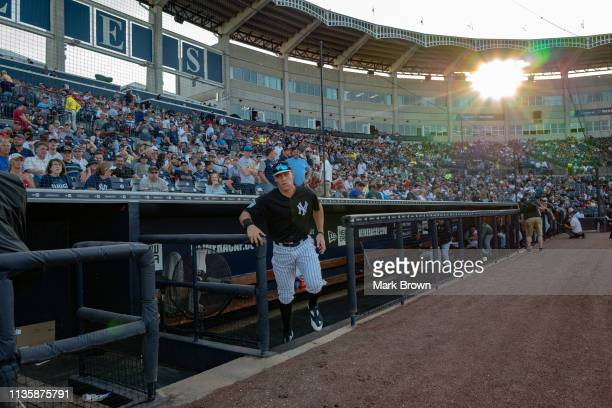 Aaron Judge of the New York Yankees leaves the dugout before the spring training game against the Philadelphia Phillies at Steinbrenner Field on...