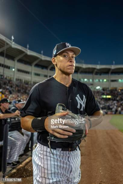 Aaron Judge of the New York Yankees leaves the dugout during the spring training game against the Philadelphia Phillies at Steinbrenner Field on...
