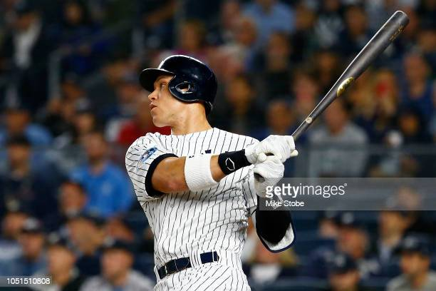 Aaron Judge of the New York Yankees lines out to right field against the Boston Red Sox during the first inning in Game Three of the American League...