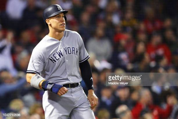 Aaron Judge of the New York Yankees looks on after scoring a run against the Boston Red Sox during the third inning at Fenway Park on September 28...