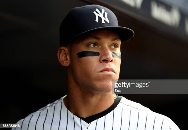 Aaron Judge of the New York Yankees looks on from the dugout before the game against the Tampa Bay Rays on April 13 2017 at Yankee Stadium in the...