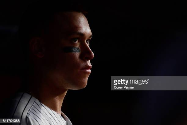 Aaron Judge of the New York Yankees looks on from the dugout during the middle of the third inning against the Boston Red Sox at Yankee Stadium on...