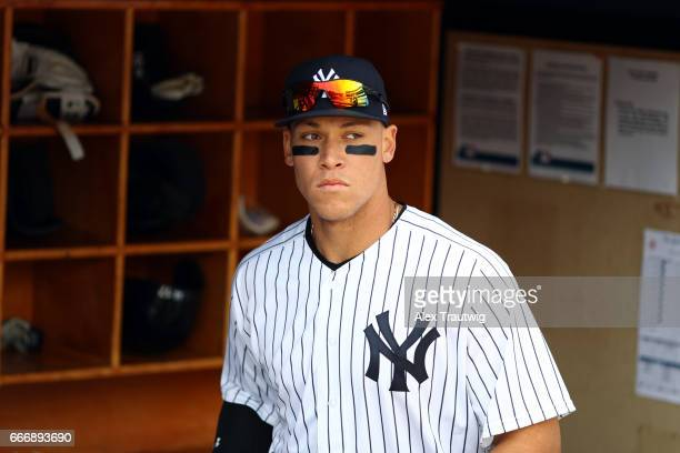 Aaron Judge of the New York Yankees looks on from the dugout prior to the game against the Tampa Bay Rays at Yankee Stadium on Monday April 10 2017...