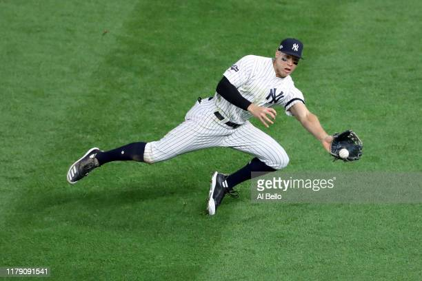 Aaron Judge of the New York Yankees makes a diving catch hit by Eddie Rosario of the Minnesota Twins to close out the top of the seventh inning in...