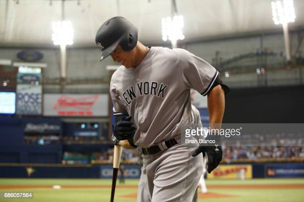 Aaron Judge of the New York Yankees makes his way back to the dugout after hitting a home run off of pitcher Matt Andriese of the Tampa Bay Rays...