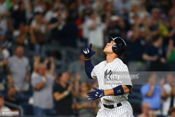Aaron Judge of the New York Yankees points to the sky after connecting on a solo home run in the fifth inning against the Milwaukee Brewers at Yankee...