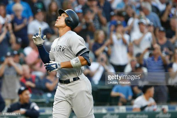 Aaron Judge of the New York Yankees points to the sky as he jogs the bases after hitting his 100th career home run in the first inning against the...