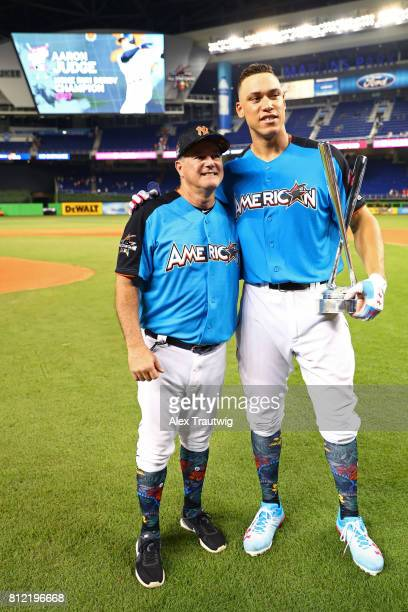 Aaron Judge of the New York Yankees poses with his pitcher Danilo Valiente after winning the 2017 TMobile Home Run Derby at Marlins Park on Monday...