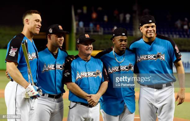 Aaron Judge of the New York Yankees poses with Yankees teammates and Danilo Valiente after winning the 2017 TMobile Home Run Derby at Marlins Park on...