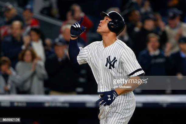Aaron Judge of the New York Yankees reacts after his seventh inning home run against the Houston Astros in Game Four of the American League...