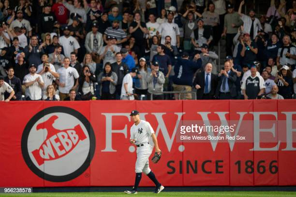 Aaron Judge of the New York Yankees reacts after making an assist from the outfield during the third inning of a game against the Boston Red Sox on...