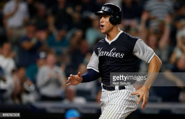 Aaron Judge of the New York Yankees reacts after scoring on an RBI double by Didi Gregorius against the Seattle Mariners during the eighth inning of...