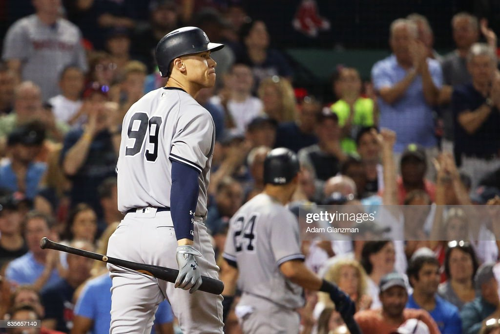 Aaron Judge #99 of the New York Yankees reacts after striking out in the seventh inning of a game against the Boston Red Sox at Fenway Park on August 19, 2017 in Boston, Massachusetts.