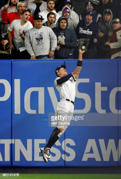 Aaron Judge of the New York Yankees robs Yuli Gurriel of the Houston Astros of a home run in the fourth inning during Game 3 of the American League...