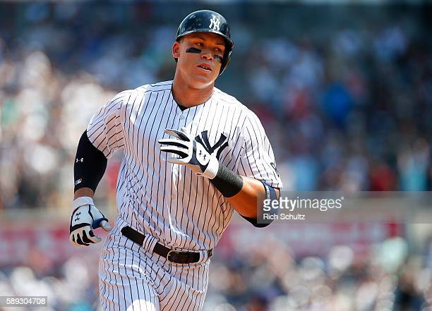 Aaron Judge of the New York Yankees rounds the bases after he hit a home run in his first MLB at bat during the second inning of a game against the...
