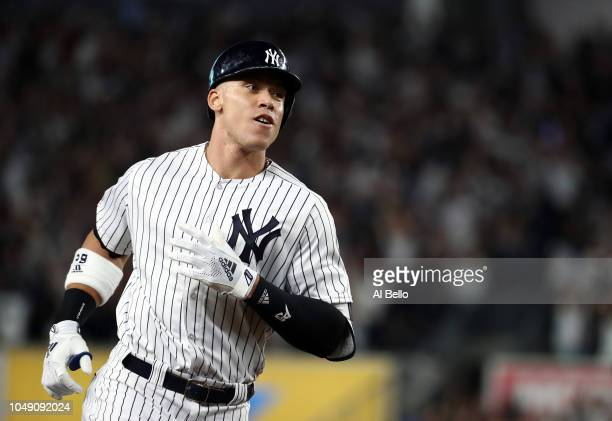 Aaron Judge of the New York Yankees rounds the bases after hitting a two run home run in the first inning against the Oakland Athletics during the...