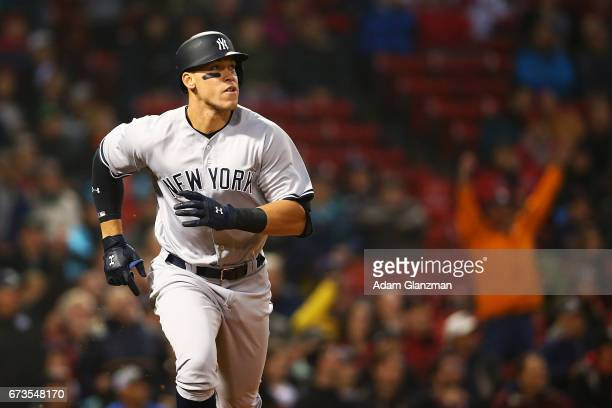 Aaron Judge of the New York Yankees rounds the bases after hitting a tworun home run in the second inning during a game against the Boston Red Sox at...