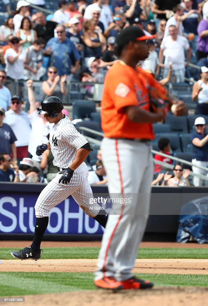 Aaron Judge #99 of the New York Yankees rounds the bases after hitting a two-run home run against Jayson Aquino #64 of the Baltimore Orioles in the seventh inning during their game at Yankee Stadium on April 29, 2017 in New York City.